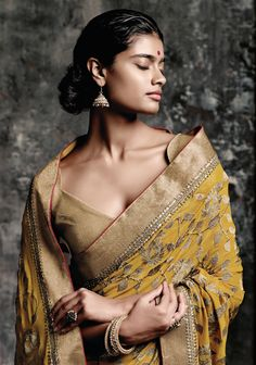 Full embroidery saree can never go out of fashion ...this golden brocade blouse…
