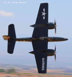 """Grumman F7F-3P Tigercat~#55-""""Here Kitty Kitty"""" (NX700F) twin-engined naval fighter at Planes of Fame Airshow-Chino, CA. May 2015."""