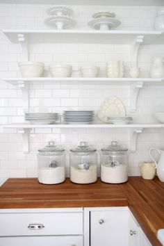 Decorating with glass canisters in the kitchen (Photo via Holly Mathis)   anderson + grant