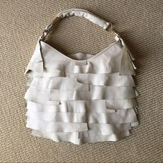 Purse Cream leather Yves Saint Laurent St Tropez bag with gold tone hardware. Ruffle embellishments, brown suede interior with zip compartment. Very good condition. Slight mark on one ruffle. Yves Saint Laurent Bags Shoulder Bags