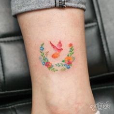 Colorful floral bird tattoo by Tattooist River