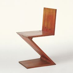 Gerrit Thomas Rietveld Zig-Zag Design: 1932-34  Production: 1935 to c.1955  Manufacturer: Metz & Co., Amsterdam  Size: 75 x 37 x 44.5; seat height 42.5 cms  Material: red-stained elm, brass screws