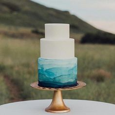 colorful wedding cakes Watercolor Wedding Cakes To Blow Your Mind Away Teal Cake, Blue Cakes, Watercolor Wedding Cake, Ocean Cakes, Painted Wedding Cake, Themed Wedding Cakes, Water Theme Wedding, Blue Beach Wedding, Dream Wedding