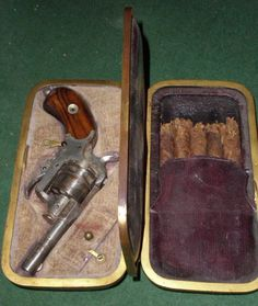 Webley Pocket Pistol C/BJ29  Wow!!! This Webley pocket pistol in original carrying case includes a separate compartment for your cigars. I don't know if the five cigars are from the period but they look very old.