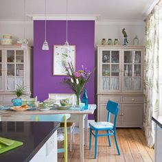 Dining room with purple feature wall and reclaimed furniture   Design