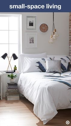 Make the most of a small bedroom with clever—and stylish—space-saving touches. Start with the bedding. A cozy, white comforter with simple, natural details creates personality without feeling messy. Add a hanging pendant lamp over your bed for more light without taking up precious nightstand/dresser space. Finish the look with some wall art and voila! Home sweet home.