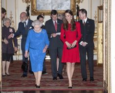 17 Feb 2014: Duchess joins HM for Royal Academy of Dramatic Arts reception at Buckingham Palace. Kate wearing bespoke Red Alexander McQueen and black Prada pumps. Accessorized with Cassandra Goad 'Temple of Heaven' girandole-style earrings and Anya Hindmarch bespoke Maud clutch.