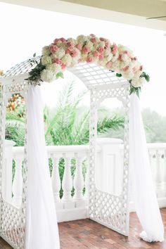 Elegant hydrangea and rose adorned arbor: http://www.stylemepretty.com/florida-weddings/brooksville-florida/2015/09/15/romantic-summer-wedding-at-southern-hills-plantation-club/   Photography: Jacqui Cole - http://jacquicole.com/