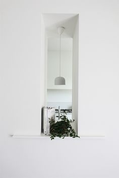 Love the idea of a small peephole between rooms, in this case kitchen and dining area. Designed...
