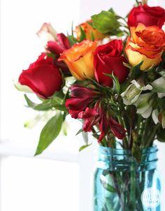 Cut flowers in a blue mason jar. Lovely! #SummerWedding #WeddingIdeas  #Flowers