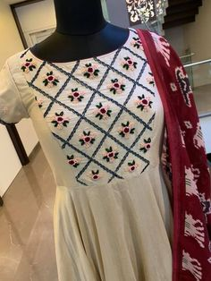 Dresses - Stunning off white color floor length dress with maroon color ikkat dupata Floor length dress with floral design hand embroidery hand embroidery work Ready to ship Price 7500 INR To order whatsap Designer Kurtis, Designer Dresses, Sari Design, Floral Design, Churidar Designs, Kurta Designs Women, Robe Anarkali, Embroidery On Clothes, Hand Embroidery Dress