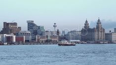 mersey ferry crosses in front of liverpool skyline at dusk - Stock Footage | by Videostock50
