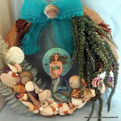 Mermaid wreath with teal bow and seashells_beach wreaths_mermaid decor_seashell wreath by CarmelasCoastalCraft on Etsy