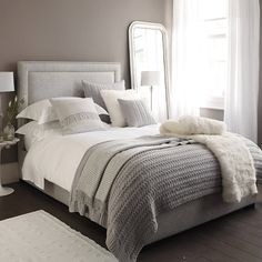 Love this grey and white bedding! Also not too girly!