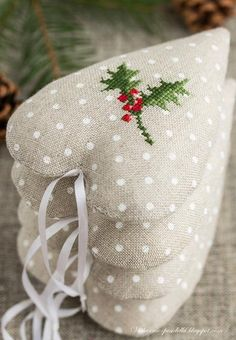 hearts ornaments with cross stitch holly