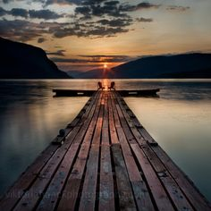 A perfect moment in time.  Sitting on the end of a dock watching the sunset with…
