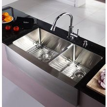 Stainless steel farmhouse sink with a divider! LOVE!