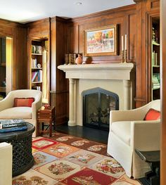 Library with wood paneling & stone Gothic/Tudor arch fireplace -- Brookes + Hill Custom Builders -- Interior design: Gauthier-Stacy -- photo: Richard Mandelkorn