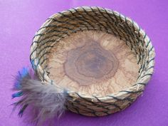 "Coiled vertiver grass roots on a wooden base 4"" by 1 1/4""  $45.00 w/ additional p/h These roots have a wonderful fragrance! SOLD"