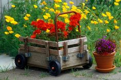 Be on the lookout for a cute cart that you can use to either transport your flowers and plants around the yard as you work or to display your pots.