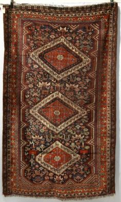 A rug by the Basseri tribe of the Khamseh Confederation, Fars, south west Persia, late 19th/early 20th century, 8ft. x 4ft. 10in. 2.44m. x 1.47m.