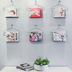 Use sturdy hangers for a clever magazine display.