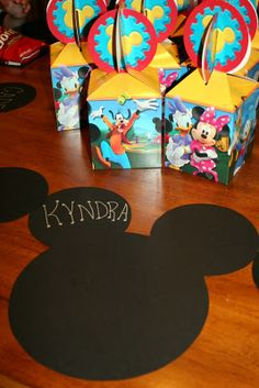 Heavy duty black paper cut into the Mickey Mouse shapes served as placemats personalized for each child.