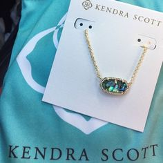 Kendra Scott Abalone Elisa I never wear this and anytime I put it on, I switch it out for my black Elisa. PRICED HIGH FOR OFFERS. No trades - trying to purchase a pair of Flash Raybans. Comes with Kendra Scott dust bag. Kendra Scott Jewelry Necklaces