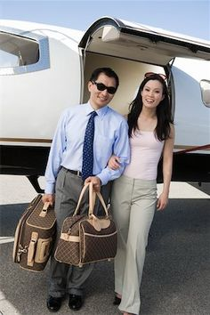 Portrait of mid-adult asian business couple standing in front of private airplane stock photo , Millionaire Dating, Millionaire Lifestyle, Romantic Gifts, Romantic Couples, Experience Gifts, Rich Man, High Society, Significant Other, Hollywood Celebrities