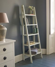 Interesting White Color Small Ladder Bookshelf Made From Wooden Upright With Wooden Glue Material With 5 Tier Space Ladder Bookshelf And Grey Color Wall Feat Grey Lacquered Wooden Flooring For Your Living Space of Awesome Small Ladder Bookshelf Inspirations  Ladder Style Bookshelves Vintage Looking Ladder Display Shelf Antique Ladder Bookshelf Small White Ladder Shelf Small Bookcases for Small Spaces . 700x848 pixels
