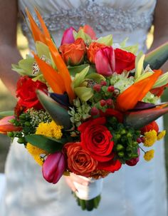 Very colorful tropical themed wedding bouquet.