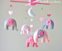 Baby crib mobile - Baby Mobile - Custom Baby Mobile -  Girl Elephant Mobile - Nursery Mobile -Pink Mobile - OR CHOOSE your colors :). $140.00, via Etsy.