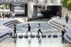 Seoul Photos at Frommer's - People cross the stream in Cheonggyecheon in Seoul, South Korea.