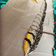 Working on a little beaded number, a flash of colour in this gold and monochromatic pheasant feather. Enjoying embroidery an arts cafe for a change of environment #arri #tambourembroidery #tambour #luneville #lunevilleembroidery #goldworkembroidery #stitchersofinstagram #embroiderydesign #embroideryinstaguild #broderie #beadersofinstagram