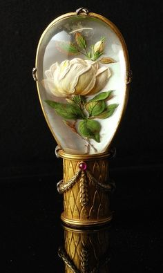 Parasol handle with a reverse intaglio depicting a rose motif. A reverse crystal intaglio is a rock crystal cabochon with an intaglio carved into the flat back, artist unknown. Walking Sticks And Canes, Walking Canes, Faberge Eier, Bijoux Art Nouveau, Cane Handles, Red Carnation, Umbrellas Parasols, Different Flowers, Crystal Flower