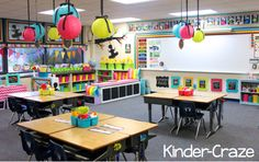 Colorful and whimsical! Love the lanterns hung with ribbon. :) And I definitely want to try putting desks into table groups