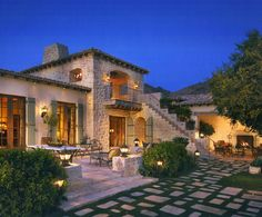 Mediterranean Style Stone House with Camelback Mountain views in Paradise Valley in Arizona by OZArchitects Inc