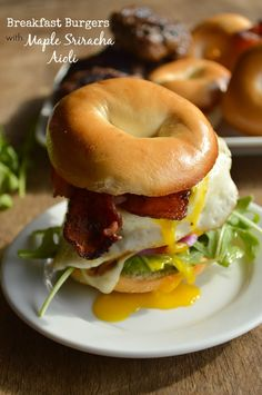 The best breakfast EVER. Breakfast Burgers with Maple Sriracha Aioli are topped with a fried egg, maple bacon & the sauce that will blow your breakfast mind