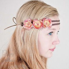 """This gorgeous headband features 3 delicate little """"Juliette"""" flowers attached to a dark brown Double Braid Boho Headband. The braids carry across 12""""of the band, and then change to15"""" of single strand suede along each end for tying. The suede is agreat choice to prevent slipping. Please allow for tiny differences from product photos, as each headband is handmade.    The lengths are perfect for girls of all ages."""