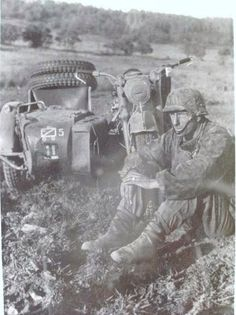 SS soldier of the 2 Pz.Div SS Das Reich and his BMW R12.