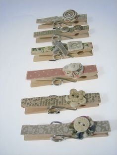 could diy this pretty easy, clothespins, buttons, and mod podge scrapbook paper