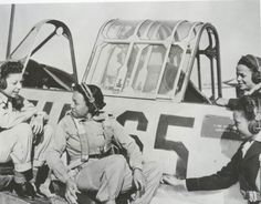 Tuskegee Air Women. Nurses learning about the cockpit.