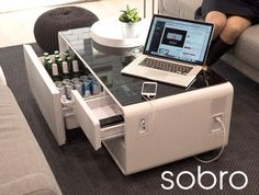 This is the Kickstarter for the Sobro, a $500 modern coffee table that includes a 24-bottle refrigerated drawer, dual Bluetooth speakers, LED light effects beneath the table, two USB charging ports, two standard electrical outlets, and a tempered glass...