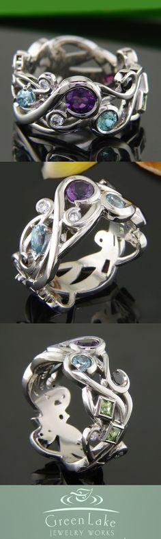 Custom #MothersRing in pierced palladium with family birthstones: White and black #diamonds, peridot, pink tourmaline, aquamarine, amethyst, and ruby. #GreenLakeJewelry