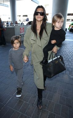 Kourtney Kardashian departs a flight at LAX Airport with her kids Mason and Penelope on May 18, 2014
