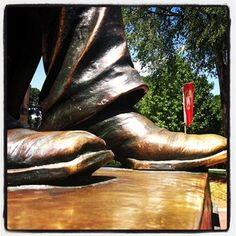 Rub Abe's foot for good luck