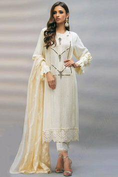 Get gorgeous in this off white georgette trouser suit which will make all the goddesses of love and beauty to write you for your advice. This round neck and full sleeve party wear suit beautified with faux mirror work. Completed with santoon cigarette pants in off white color with off white nazneen dupatta. Cigarette pant is plain. Dupatta elaborated using thread work and sequins work. #trousersuit #salwarkameez #malaysia #Indianwear #Indiandresses #andaazfashion Trouser Suits, Trousers, Pantalon Cigarette, Chiffon Pants, Pakistani Salwar Kameez, Off White Color, Jacket Style, Indian Dresses, Indian Wear