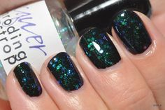 Lilacquer Schrodinger's Catastrophe color shifting topcoat (over navy).  Store closed.  Swatched on nail wheel.