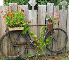 UP-CYCLED BIKE PLANTER: Don't throw it - grow in it! An old bicycle can be repurposed with micro container gardens and even used as a trellis for a climber like a grape vine. Mounted on a fence, you c (Diy Garden Art) Unique Garden, Diy Garden, Spring Garden, Garden Projects, Fence Garden, Garden Landscaping, Diy Fence, Landscaping Ideas, Garden Care