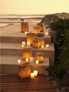 Wanting to have candles at your beach wedding? This is a great idea for setup and when you use my flameless battery operated tea light candles you won't have to worry about them being blown out by the sea breeze :) http://www.candlesrecharge.com.au